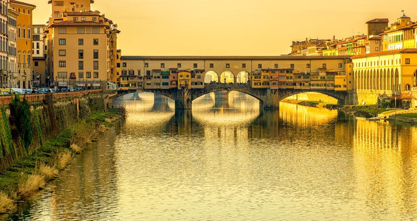 Ponte Vecchio over Arno river in Florence, Italy. Sunsrt light.